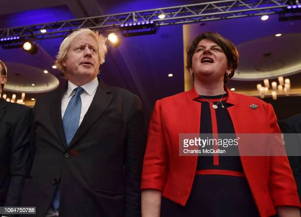 Leader Arlene Foster and Conservative MP Boris Johnson sing God Save The Queen during the Democratic Unionist Party annual conference at the Crown...