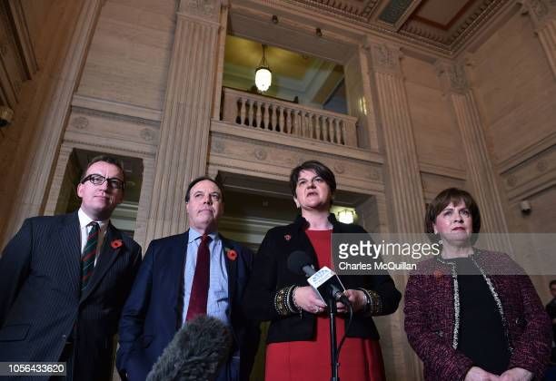 Leader Arlene Foster and deputy leader Nigel Dodds address the media at Stormont alongside party members Christopher Stalford and Diane Dodds...