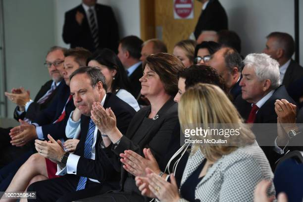 DUP leader Arlene Foster and deputy leader Nigel Dodds applaud as British Prime Minister Theresa May deliveres a keynote speech at the Waterfront...