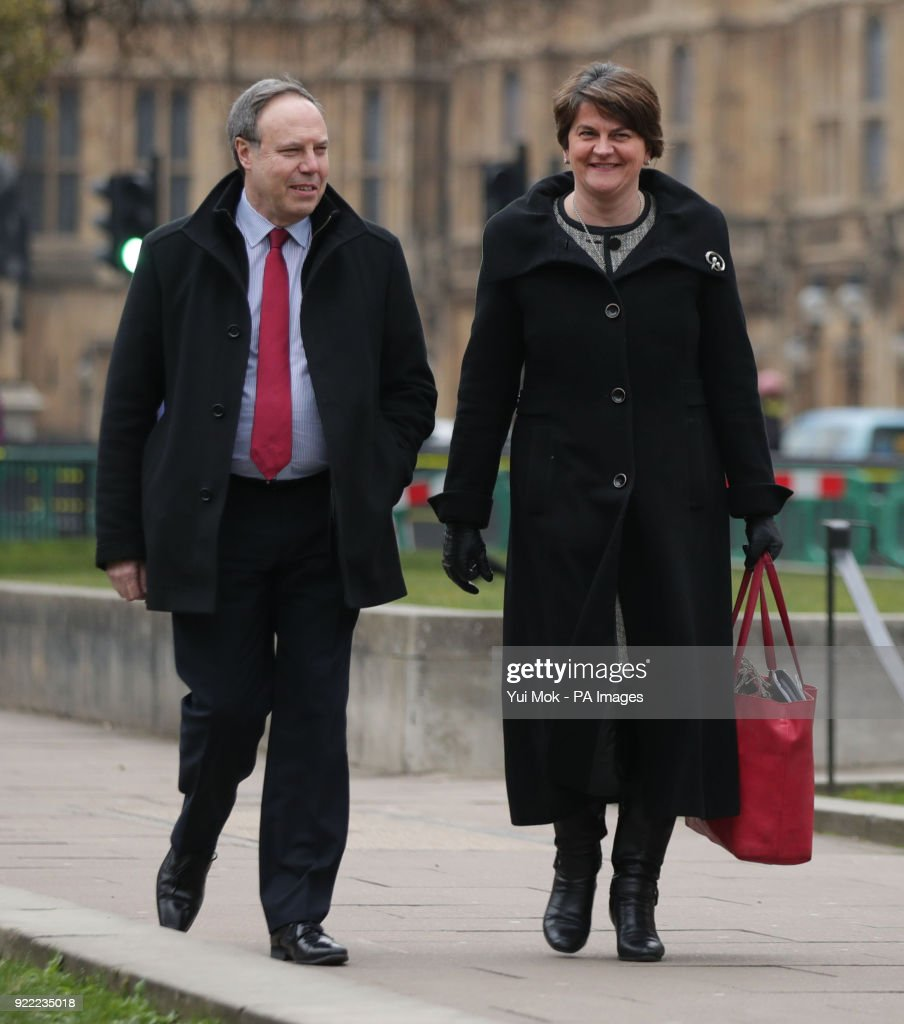 DUP leader Arlene Foster and deputy leader Nigel Dodds before speaking to the media on College Green in Westminster, London.