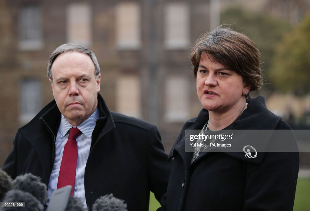 DUP leader Arlene Foster and deputy leader Nigel Dodds speaking to the media on College Green in Westminster, London.