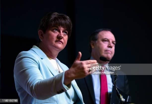 Leader Arlene Foster delivers the Democratic Unionist party manifesto alongside deputy leader Nigel Dodds during a press conference on November 28,...