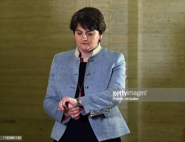 Leader Arlene Foster looks at her watch at Stormont following news that Sinn Fein have also accepted to go back in to a power sharing government with...