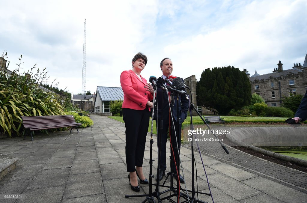 DUP leader Arlene Foster stands alongside deputy leader Nigel Dodds as they hold a press conference at Stormont Castle as the Stormont assembly power sharing negotiations reconvene following the general election on June 12, 2017 in Belfast, Northern Ireland. Discussions between the DUP and the Conservative party are also continuing in the wake of the UK general election as Prime Minister Theresa May looks to form a government with the help of the Democratic Unionist parties ten Westminster seats. Stormont and the political situation in Northern Ireland has been in limbo following the collapse of the power sharing executive due to the Renewable Heat Incentive scheme scandal which implicated the DUP.