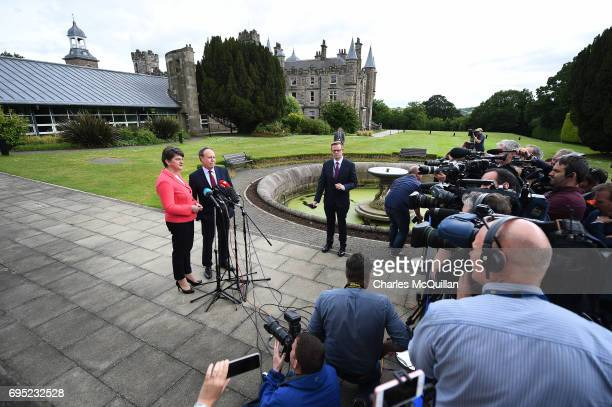DUP leader Arlene Foster stands alongside deputy leader Nigel Dodds as they hold a press conference at Stormont Castle as the Stormont assembly power...