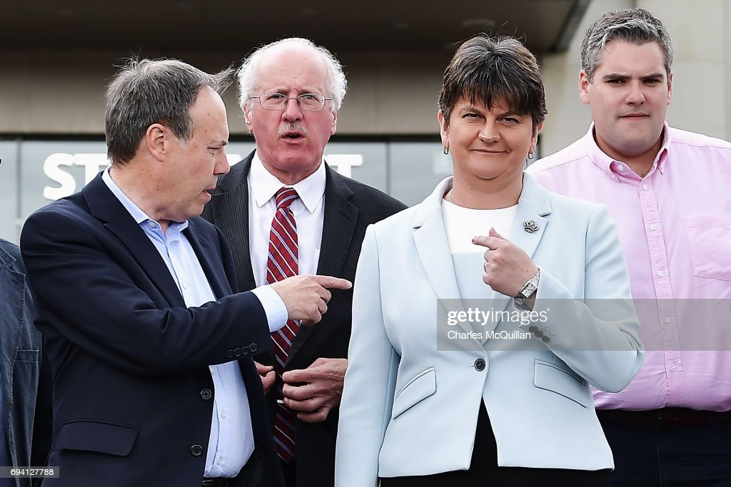 Leader Arlene Foster (R) stands with DUP Deputy Leader Nigel Dodds (L) and fellow DUP MP's after addressing the news of a possible Parliamentary agreement with the Conservative party following yesterday's election on June 9, 2017 in Belfast, Northern Ireland. After a snap election was called by Prime Minister Theresa May the United Kingdom went to the polls yesterday. The closely fought election has failed to return a clear overall majority winner and Theresa May hopes to form a minority Government with the support of Northern Ireland's Democratic Unionist Party.