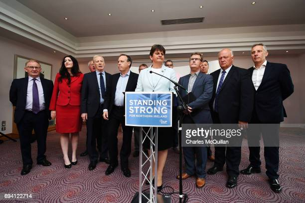 DUP leader Arlene Foster stands with fellow DUP MP's as she addresses the news of a possible Parliamentary agreement with the Conservative party...