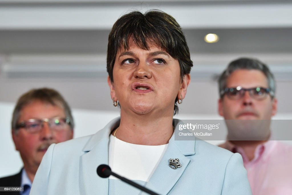 DUP leader Arlene Foster stands with fellow DUP MP's as she addresses the news of a possible Parliamentary agreement with the Conservative party following yesterday's election on June 9, 2017 in Belfast, Northern Ireland. After a snap election was called by Prime Minister Theresa May the United Kingdom went to the polls yesterday. The closely fought election has failed to return a clear overall majority winner and Theresa May hopes to form a minority Government with the support of Northern Ireland's Democratic Unionist Party.