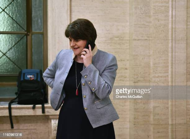 Leader Arlene Foster talks on her phone at Stormont following news that Sinn Fein have also accepted to go back in to a power sharing government with...
