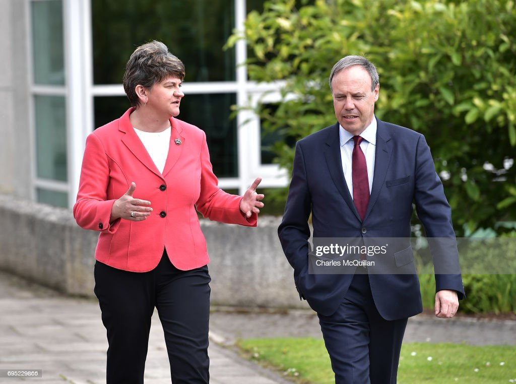 DUP leader Arlene Foster walks alongside deputy leader Nigel Dodds as they make their way from a press conference at Stormont Castle as the Stormont assembly power sharing negotiations reconvene following the general election on June 12, 2017 in Belfast, Northern Ireland. Discussions between the DUP and the Conservative party are also continuing in the wake of the UK general election as Prime Minister Theresa May looks to form a government with the help of the Democratic Unionist parties ten Westminster seats. Stormont and the political situation in Northern Ireland has been in limbo following the collapse of the power sharing executive due to the Renewable Heat Incentive scheme scandal which implicated the DUP.