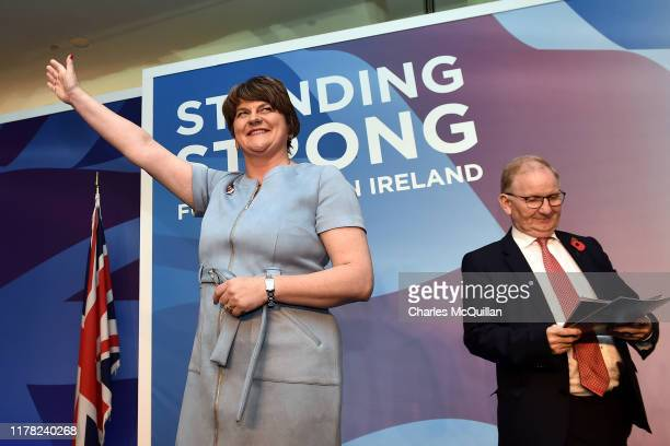 Leader Arlene Foster waves as she delivers her speech during the annual Democratic Unionist Party conference on October 26, 2019 in Belfast, Northern...