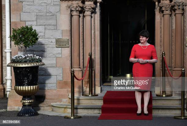 DUP leader Arlene Foster waves goodbye to former US President Bill Clinton at the Culloden Hotel following a private meeting on October 17 2017 in...