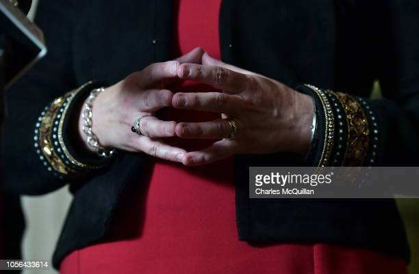 DUP leader Arlene Foster's hands can be seen as she addresses the media at Stormont following talks with the UK Brexit secretary Dominic Raab on...