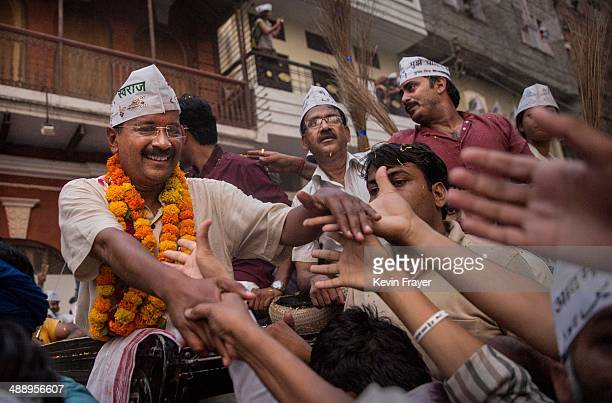 AAP leader Arvind Kejriwal is greeted by supporters during a rally by the leader on May 9 2014 in Varanasi India India is in the midst of a ninephase...