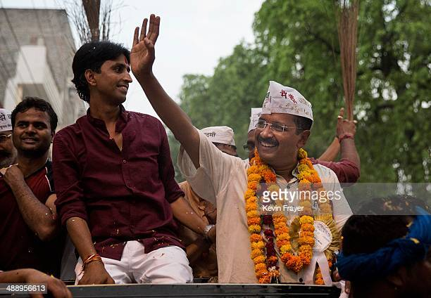AAP leader Arvind Kejriwal waves as he rides on an open jeep during a rally by the leader on May 9 2014 in Varanasi India India is in the midst of a...