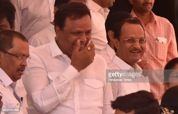 BJP leader Ashish Shelar and NCP leader Ajit Pawar interact after State Budget 2017 2018 outside Vidhan Bhawan on March 18 2017 in Mumbai India...