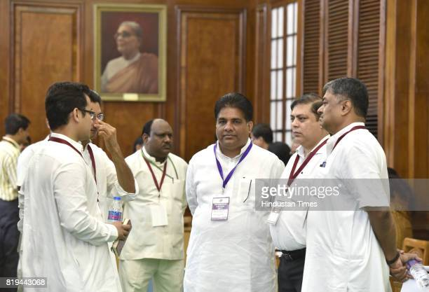 BJP leader Bhupender Yadav with Congress leaders Deepender Huda and others during the President's election counting at Parliament House on July 20...