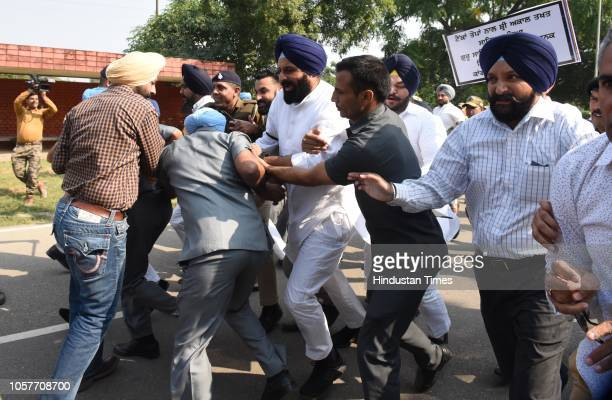 SAD leader Bikram Singh Majithia along with supporters during a protest outside the residence of Punjab Chief Minister Amarinder Singh against...