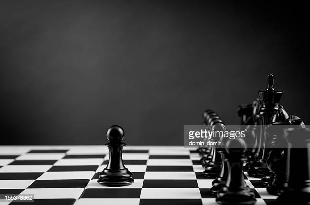 Leader, Black Chess Pawn on chess board, black and white