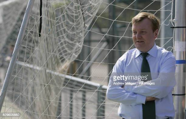 Leader Charles Kennedy on the election campaign trail watches a childen's football coaching session