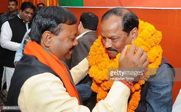 BJP leader congratulate newly elected Chief Minister of Jharkhand Raghuvar Das during the BJP legislatures meeting at state BJP office on December 26...