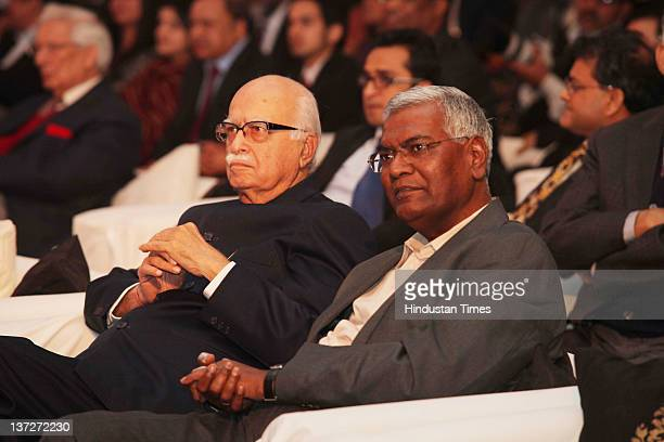 CPI leader D Raja and BJP leader LK Advani attend the 'Ramnath Goenka Excellence in Journalism Awards 20102011' on January 16 2012 in New Delhi India...