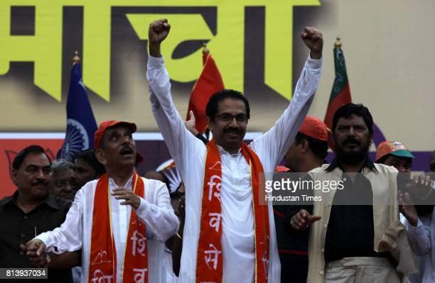 BJP leader Eknath Khadse Shiv Sena MP Manohar Joshi Shiv Sena Executive President Uddhav Thackeray and RPI President Ramdas Athawale during a joint...