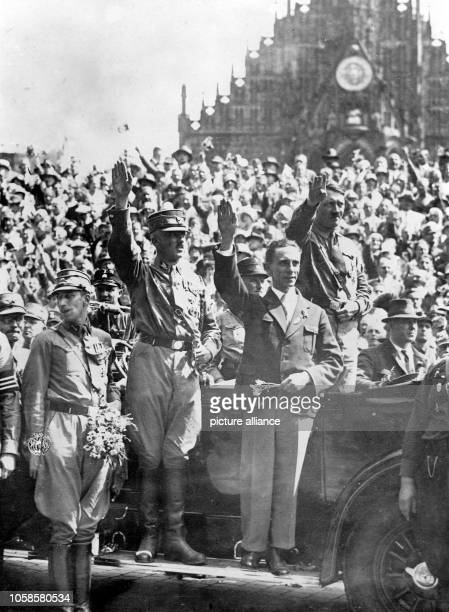 SA leader Franz Pfeffer von Salomon Reich propaganda leader Joseph Goebbels and the head of the NSDAP Adolf Hitler during the Reich convention of the...