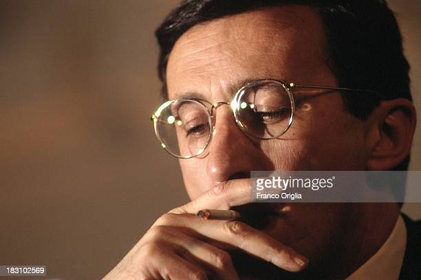 AN leader Gianfranco Fini smokes a cigarette during the national congress of 'Alleanza Nazionale' party announcing its new name from former MSI on...