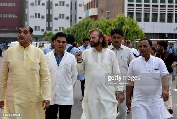Leader Hans raj Hans leaves after meeting the cleaning staff of AIIMS during the launch of partys 'Seva Saptah', at All India Institute of Medical...