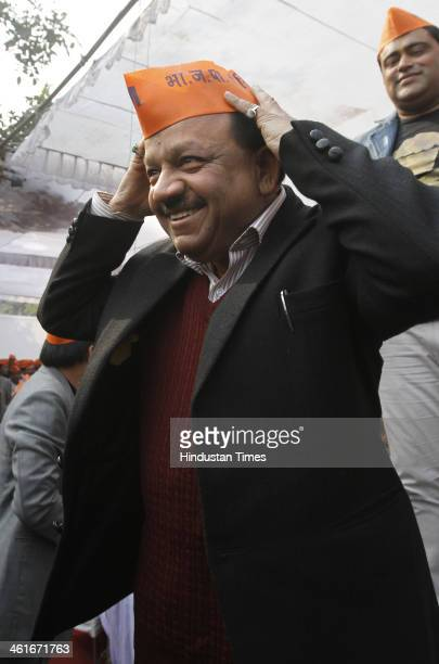 BJP leader Harshvardhan wearing saffron caps with the slogan Modi for PM during protest against ruling AAPs alleged failure to fulfill it prepoll...