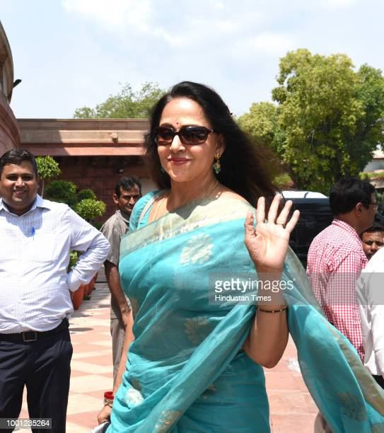 BJP leader Hema Malini arrives at the Parliament house on the first day of the Monsoon session on July 18 2018 in New Delhi India Lok Sabha Speaker...