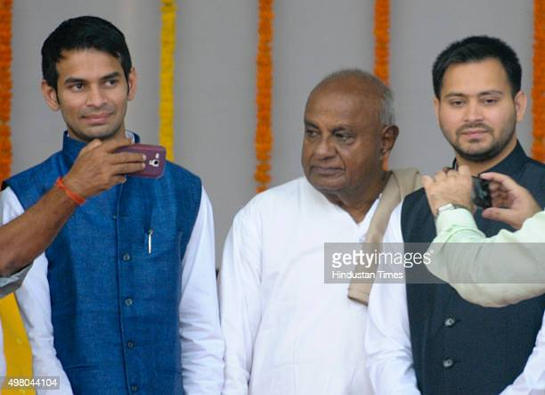JDS leader HHD Devegowda with sons of RJD Chief Lalu Yadav Tejasvi Yadav and Tej Pratap Yadav after the oath ceremony at Gandhi Maidan on November 20...