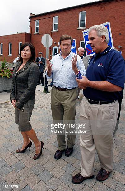 TORY10/02/07PC leader John Tory talks with party candidate Phil Bannon while his wife Barbara Hackett looks on during a walk along Main Street in...