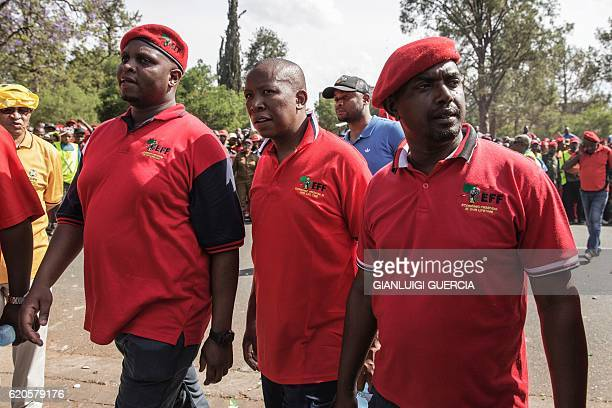 EFF leader Julius Malema arrives to talk with South African police as Members and supporters of the South African opposition party the Economic...