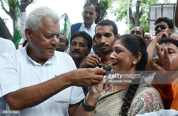 RJD leader Kanti Singh celebrates with supporters after victory in Bihar assembly bypolls on August 25 2014 in Patna India RJDJDUCongress alliance...