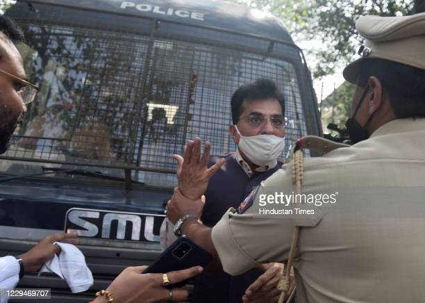 BJP leader Kirit Somaiya stands in front of a police van when police took Arnab Goswami to Alibag Court from police station on November 4 2020 in...