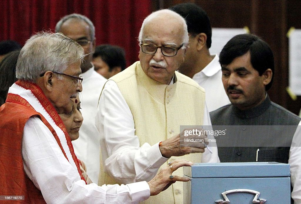 'NEW DELHI, INDIA - AUGUST 7: BJP leader L K Advani with party leaders Musli Manohar joshi and Shahnawaz Hussain casting vote for the election of Vice President at Parliament house on August 7, 2012 in New Delhi, India. (Photo by Sunil Saxena/Hindustan Times via Getty Images)'