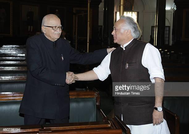 BJP leader Lal Krishna Advani talking with Congress leader Jairam Ramesh during a function to pay tribute to Bharat Ratan C Rajagopalachari on his...