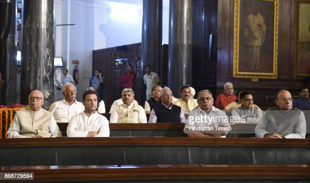 BJP leader LK Advani with Congress Vice President Rahul Gandhi and Finance Minister Arun Jaitley during a floral tribute ceremony on the portrait of...