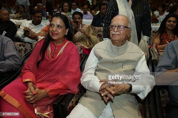 BJP leader LK Advani with his daughter Pratibha Advani during onstage comic play Pati Patni aur Main on April 19 2015 in New Delhi India