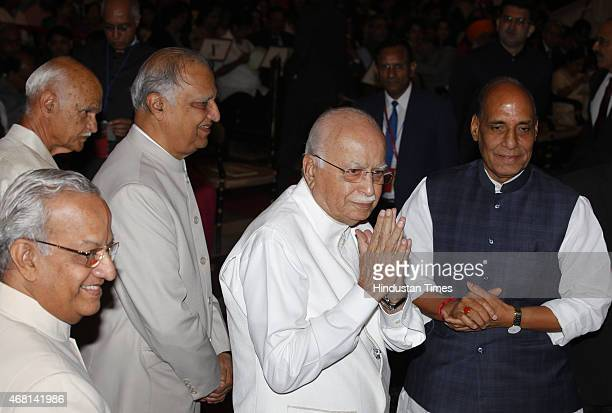 Leader LK Advani with Home Minister Rajnath Singh before receiving the Padma Vibhushan award from President Pranab Mukherjee during a Civil...