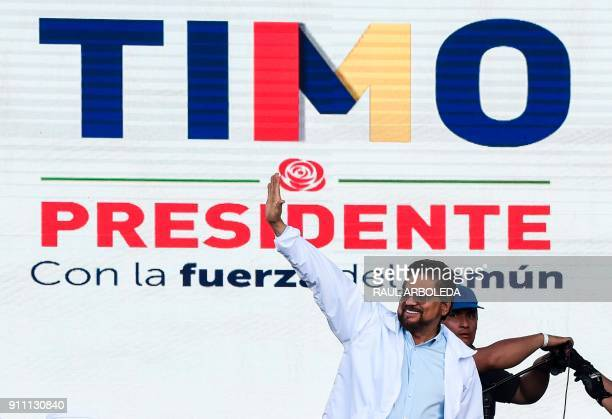 FARC leader Luciano Marin Arango aka 'Ivan Marquez' greets supporters during the launch of the political campaign for president of his comrade...
