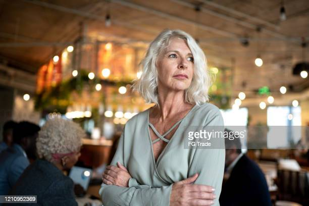 leader mature businesswoman dreaming at work - gratitude stock pictures, royalty-free photos & images