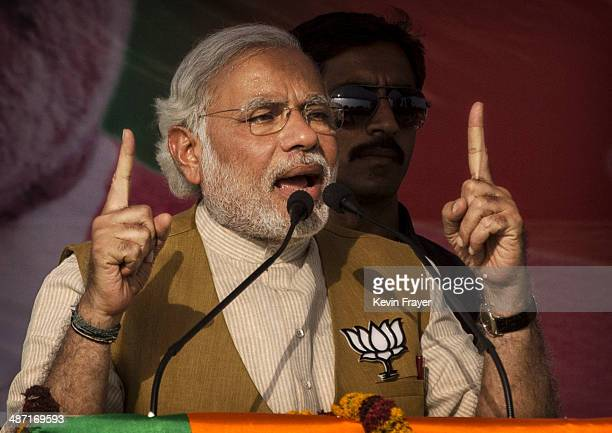 BJP leader Narendra Modi gestures as he speaks to the crowd at a rally on April 27 2014 in Sidhuali near Lucknow India India is in the midst of a...