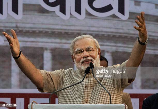 BJP leader Narendra Modi gestures while speaking to supporters after his landslide victory in elections on May 16 2014 in Vadodara India Early...