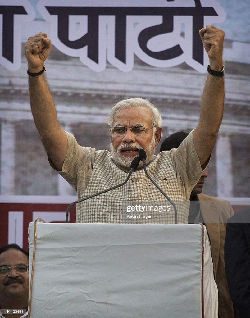 BJP leader Narendra Modi gestures while speaking to supporters after his landslide victory in elections on May 16, 2014 in Vadodara, India. Early indications from the Indian election results show Mr Modi's Bharatiya Janata Party was ahead in 277 of India's 543 constituencies where over 550 million votes were made, making it the largest election in history.