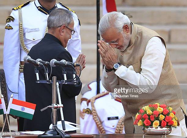 BJP leader Narendra Modi greets President Pranav Mukherjee after taking oath as the 15th Prime Minister of India at a ceremony at Rashtrapati Bhavan...