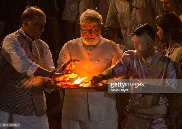 BJP leader Narendra Modi performs the Hindu Ganga Puja prayer ritual at the Dashaswamadeh Ghat on the Holy River Ganges the day after his landslide...