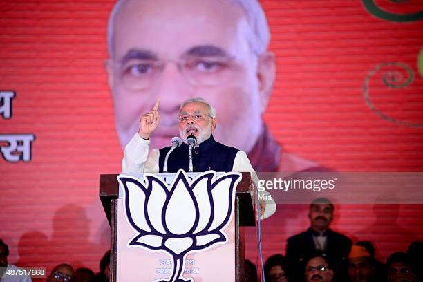 BJP leader Narendra Modi speaks during the party's national council meeting at Ramlila ground on January 19 2014 in New Delhi India